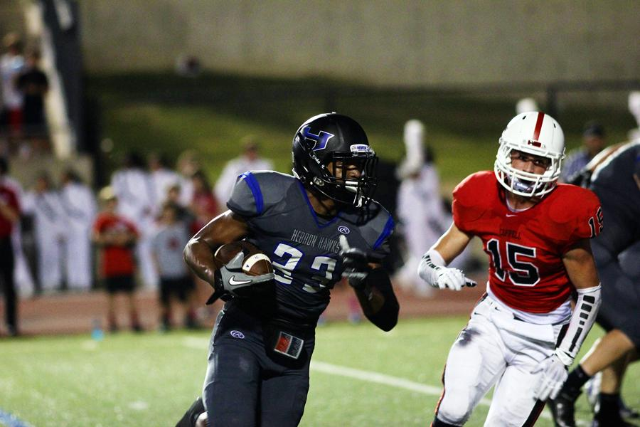 Jamal+Adams+runs+past+the+Coppell+defense+to+tie+the+score+14-14.+This+tie+did+not+last+long+as+Coppell+ended+the+first+half+with+a+17-14+lead.