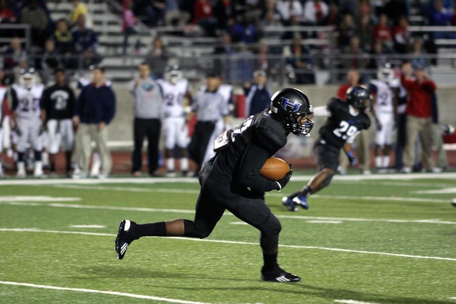 Junior running back Angelo Garbutt prepares to return a short kick during an early drive. Garbutt only had the one kick return during the game.
