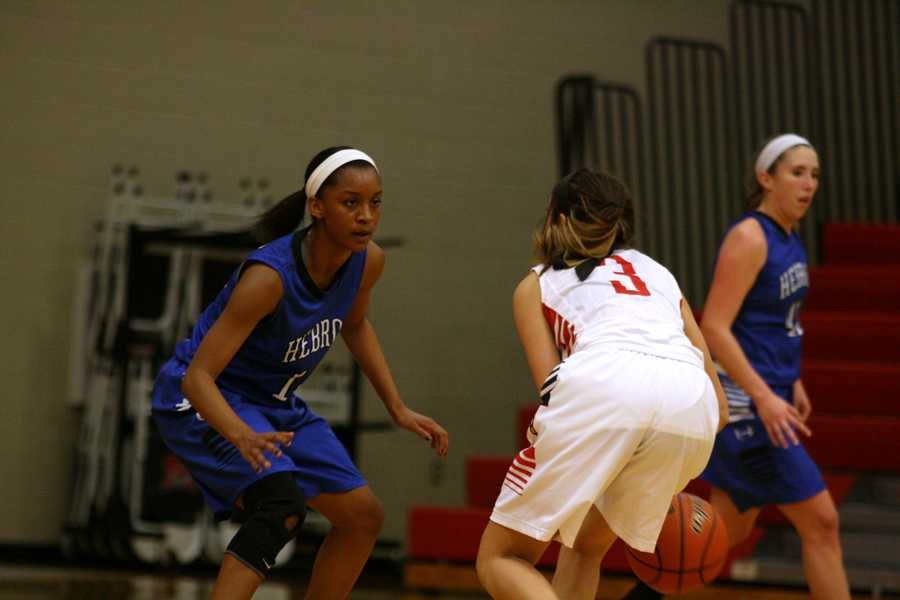 Sophomore Stefanie Mitchell focuses on her defense .