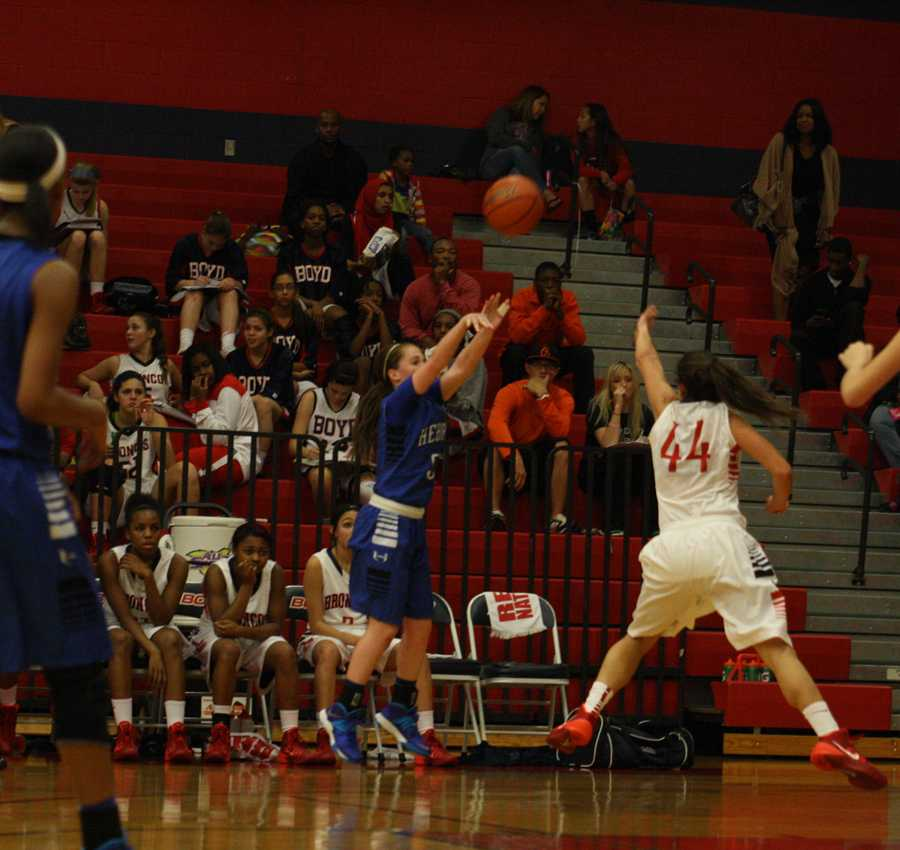 Junior Grace Pospichal goes up for the shot.