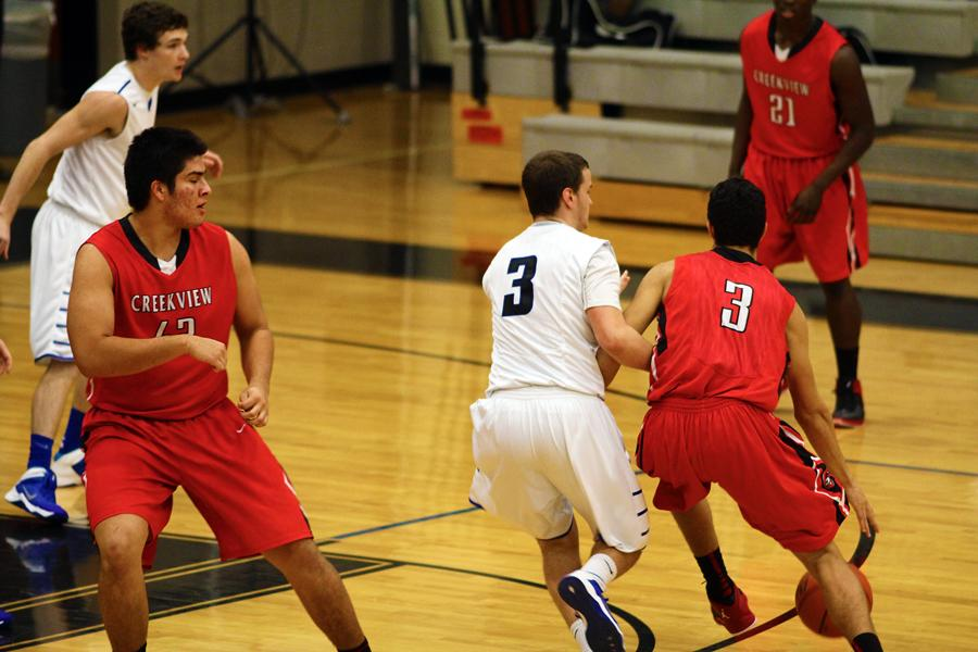 Senior guard Ryan Sherrod tries to keep his man from getting into the paint