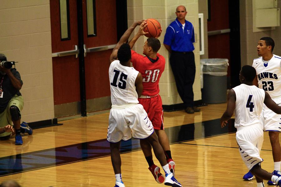 Senior center LaRandall Scroggins played good defense throughout the game, shown here when he attempts to block a shot