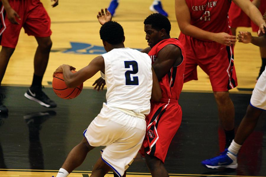 Sophomore guard Isaiah Gary tries to dribble around a defender