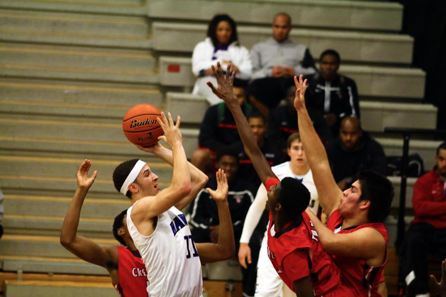 Junior power forward Tyler Williams goes up for a tough jump shot over two Creekview defenders