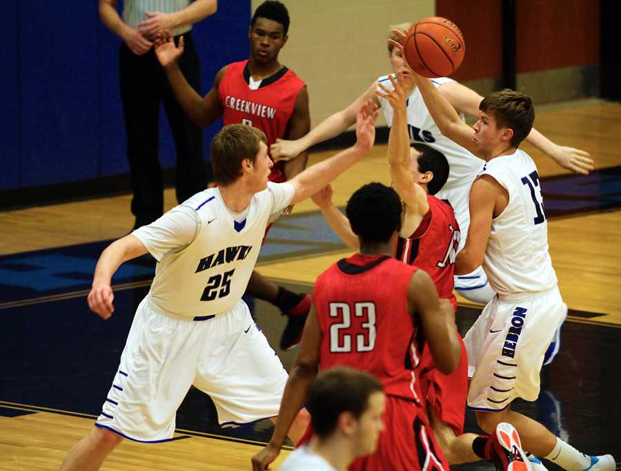 McClenaghan and sophomore guard Timothy Hart poke the ball away from a Creekview point guard