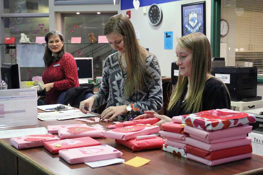 Library assistants wrap the Blind Date books