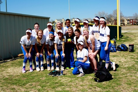 Head Coach Staci Jackson was presented with a signed game ball for her one hundredth win.