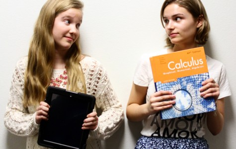 Staff writers Olivia Bragg and Megan Oosthuizen face off to debate the preference over tablets or textbooks.