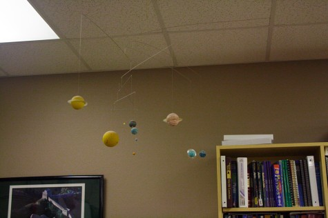 Kuhn decorates his classroom with rotating models of the solar system.