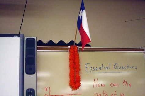 Kuhn expresses his Texas, and Hawaiian, pride by decorating his board with the Texas flag and a lei.