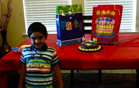 5 year old Hasu is smiling bright for the world to see on his brithday.