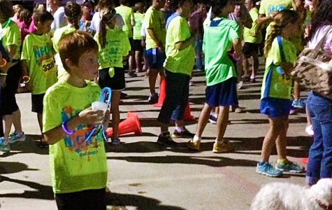 Allison Harrison's son took a hydration break after the race as he waited for his mom to finish.  Photo By: Olivia Bragg