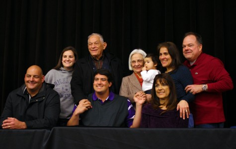 David Brazil plus his grandparents and other family members stand close together for their picture. Photo by: Olivia Bragg