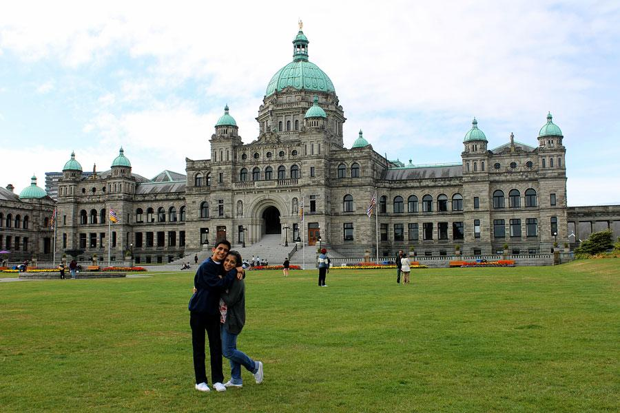 Bordbar and his sister in front of the British Columbia Parliament Buildings located in Canada.