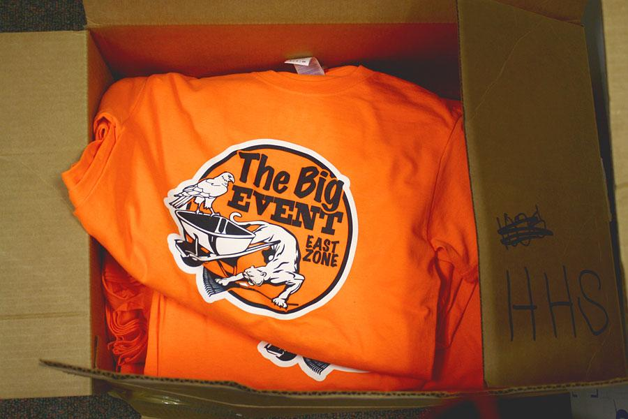 The Big Event t-shirts sit fresh in the boxes. AP English 3 teacher Julie Cummings handed them out in her room 1545.