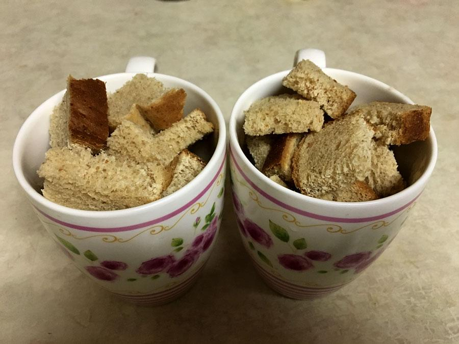 I+cubed+three+slices+of+bread+and+put+them+into+the+mugs.+