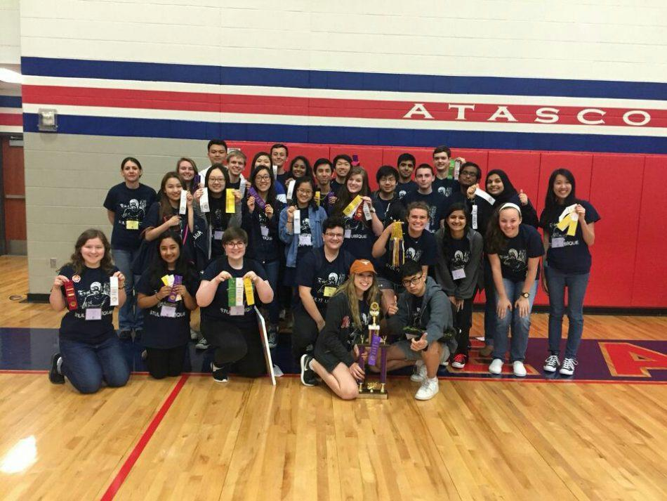 The team poses with their awards after a successful competition at Atascocita High School.