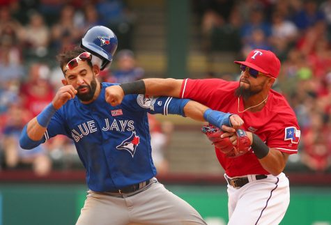 Toronto Blue Jays Jose Bautista (19) gets hit by Texas Rangers second baseman Rougned Odor (12) after Bautista slid into second in the 8th inning at Globe Life Park on May 15, 2016 in Arlington, Texas. The Rangers won 7-6. (Richard W. Rodriguez/Fort Worth Star-Telegram/TNS)