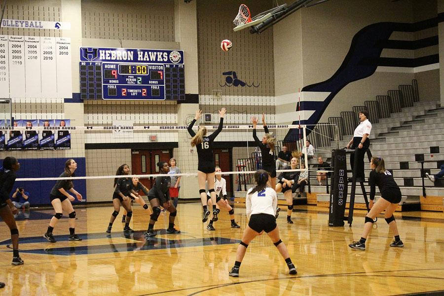 Sophomore Emma Clothier and Senior Kylee McLaughlin block the incoming spike.