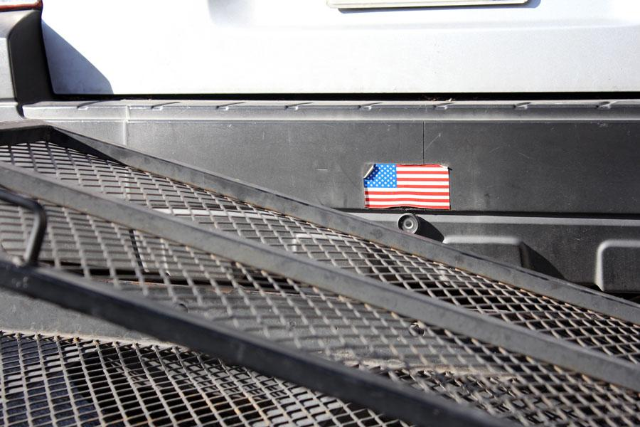 An American flag stuck on the back of a truck