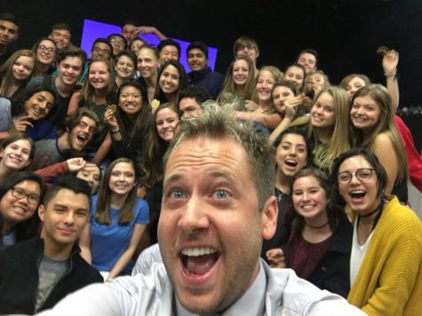 Corey Broom poses for a selfie with the theatre department.