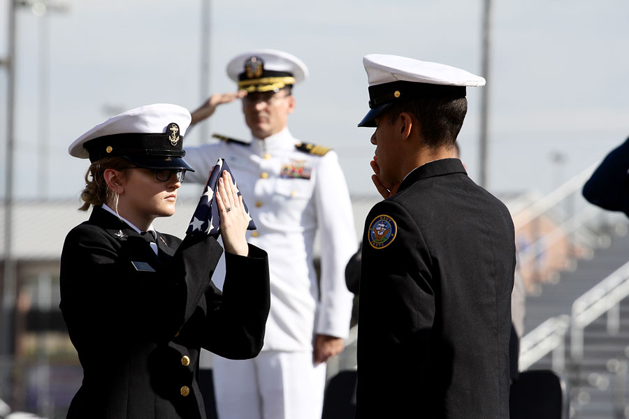 Junior Sophia Hunt accepts the flag as she is saluted. Konnor Halteman recited