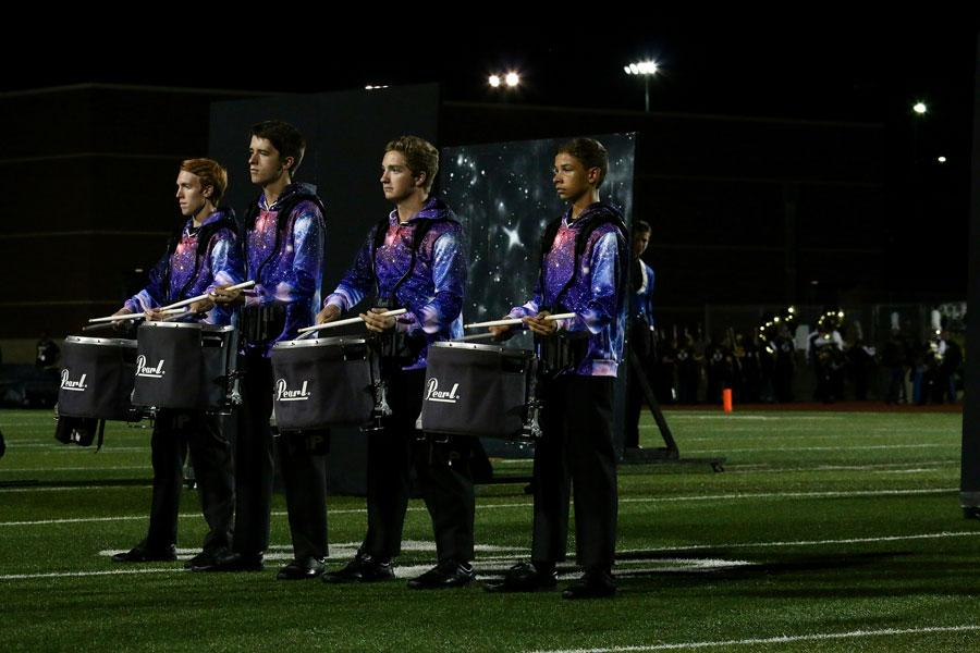 Members of drumline perform their space-themed show.