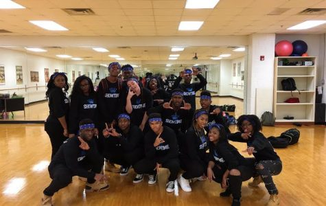 The step team gathers together before their first performance.