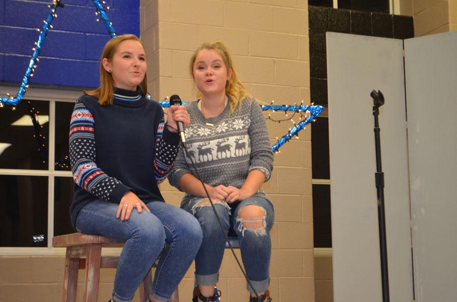 Junior Caroline Wagner and sophomore Courtney Carroll sing a duet together.