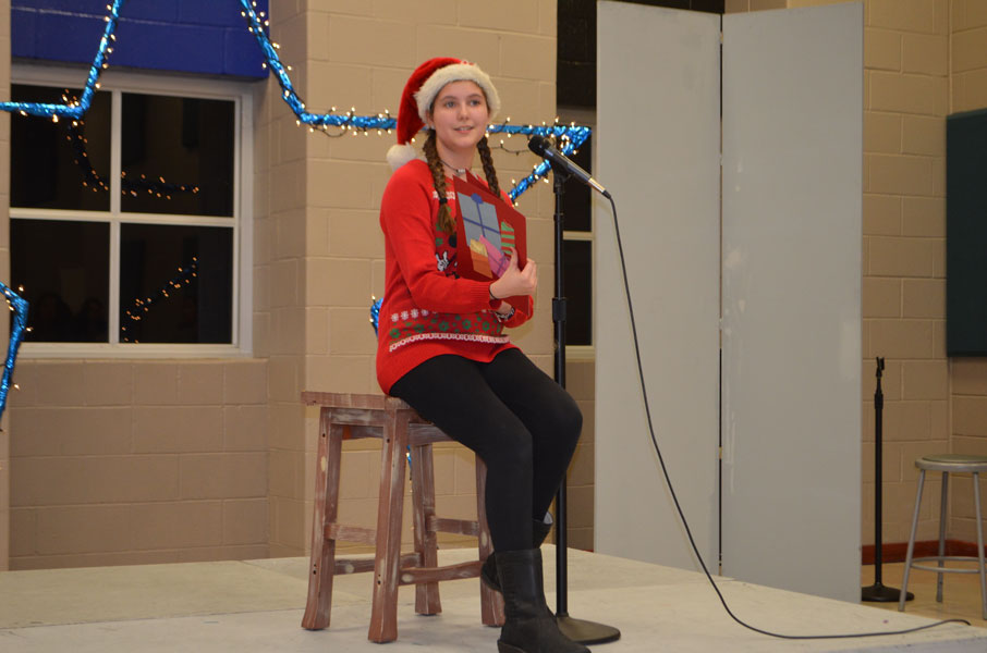 Sophomore Reagan Whiteley reads from a poem.