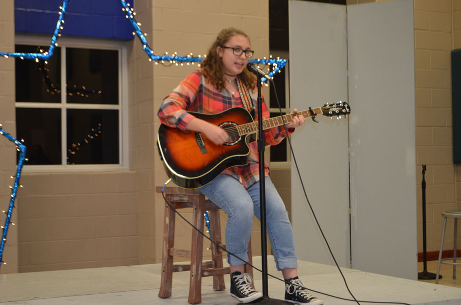 Sophomore Chloe Bergerman plays a song on the guitar.