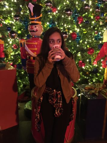Me drinking hot chocolate Downtown Disneyland in front of some of the many Christmas decorations there.