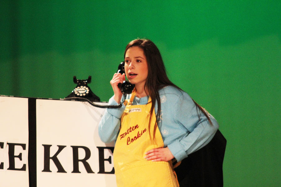 Inita Goodwin, played by Ashley Newman, answers calls at her restaurant.
