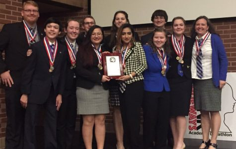 AcDec team poses with award after winning second place in region competition.