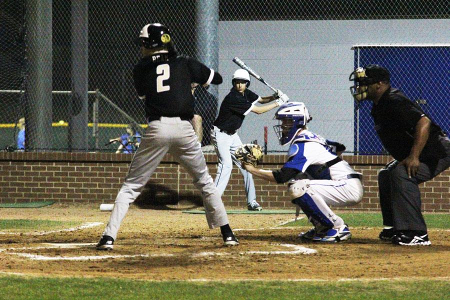 Catcher Aiden Davis waits for the ball. Davis played six innings in the field, the most on the team