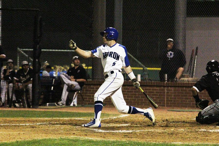 Jake Tidwell hits for the Hebron Hawks. Tidwell also pitched in the inning before.