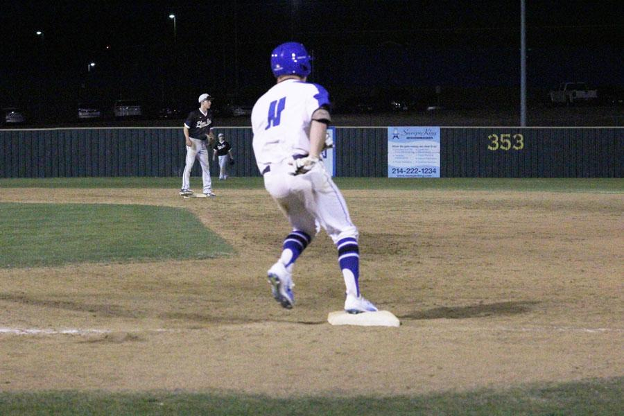 Zachary Deloach runs and makes it to first base. Deloach made multiple hits during the game.