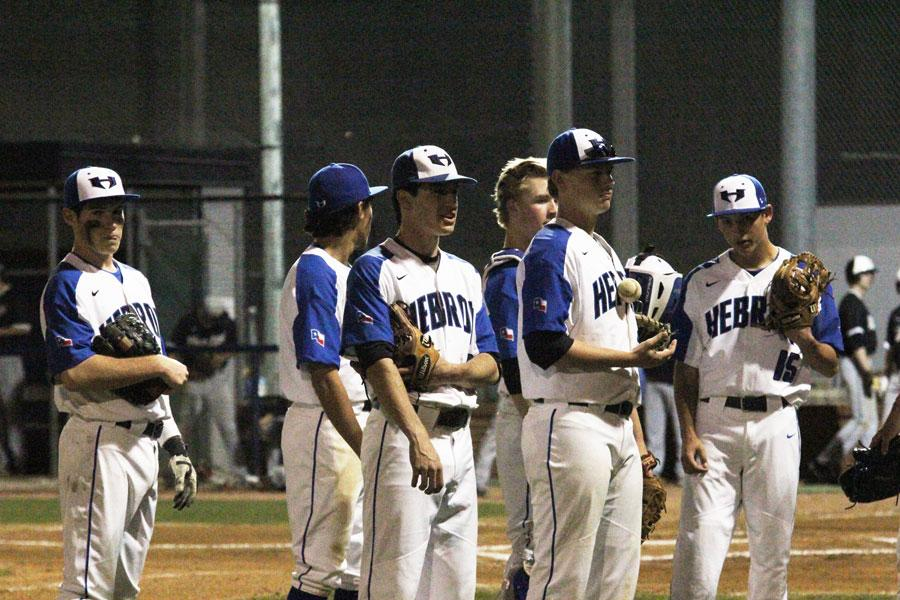 The+Hawks+practice+together+before+the+game.+Before+every+inning%2C+the+team+huddles+up+to+make+a+game+plan.