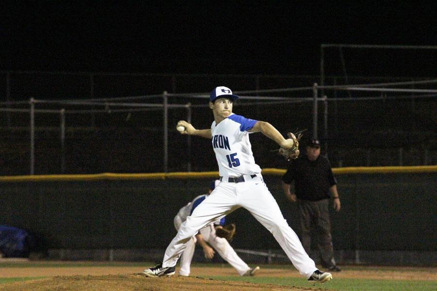Landon Muzzy pitches for the Hawks. Muzzy started the game, striking out three.
