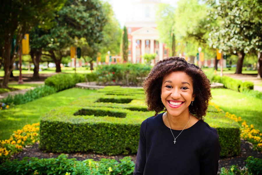 Connor poses for her senior pictures in front of the Patt Neff building at Baylor.