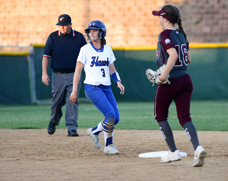Senior Sydney Streenz stays close to second base as she watches her teammate bat. Streenz was trying to steal third base, but the inning ended before she could.