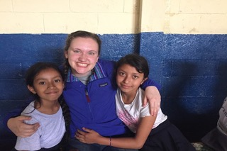 Sydney poses with two girls she met in Guatemala. She met them during a bible study program.