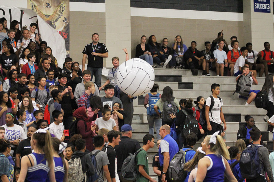 Students play crowd volleyball while waiting for the pep rally to start.