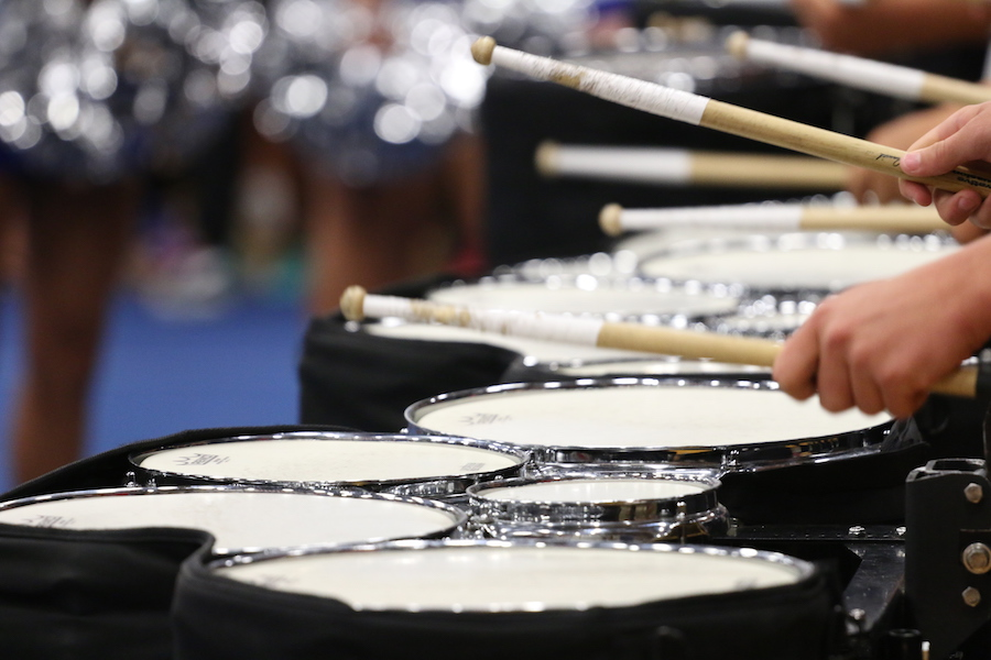 The+drumline+warms+up+for+the+pep+rally.+They+were+preparing+for+the+pep+rally+as+well+as+their+first+contest.