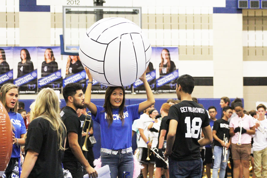 Senior Haneul Kim and other Ruckus and Rowdy members playfully prepare prior to the pep rally.