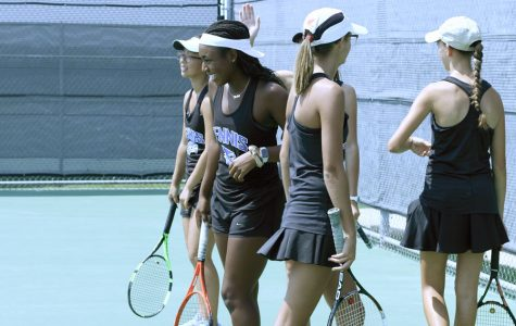 Varsity tennis girls practice before heading out to play Allen.