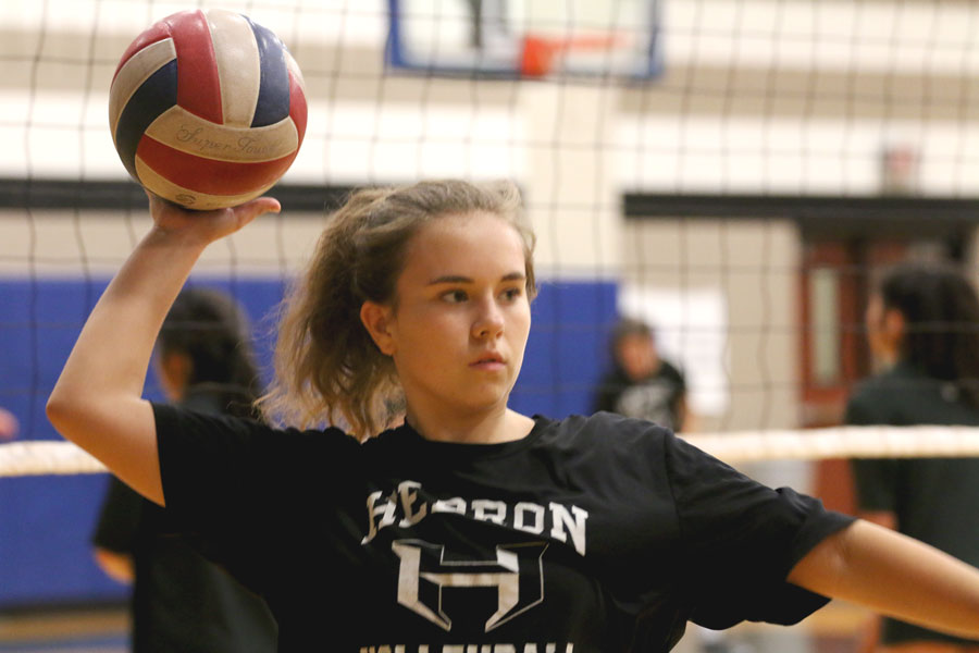 Sophomore Emily Szukala get ready to serve the ball during practice. She plays for the junior varsity team.