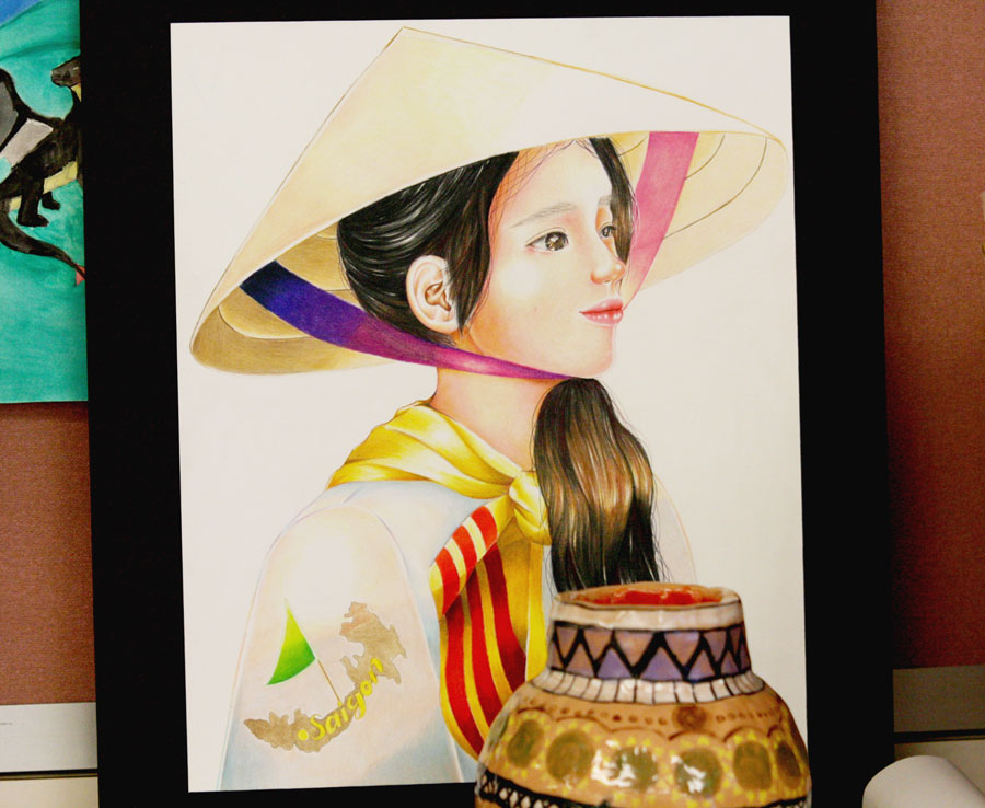 Two art pieces that were entered into the Hispanic Heritage Month art contest that was held from Sept. 15 to Oct. 15. The first prize winner was junior Evelyn Kha who made the portrait in the photo.