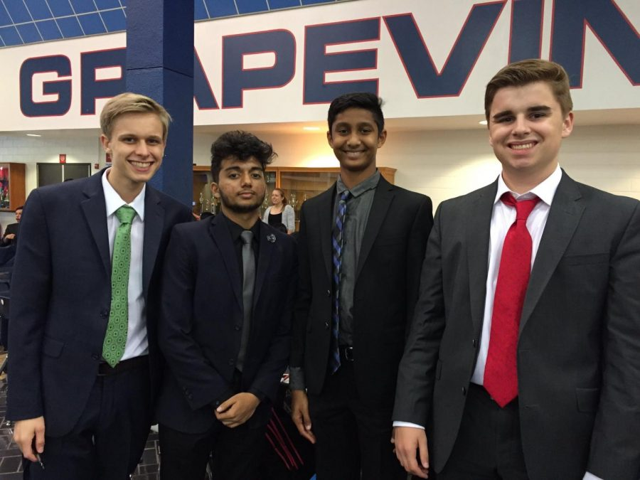 Shamblin (on right) with his friends at a debate tournament. They were competing at the Grapevine Invitational tournament.