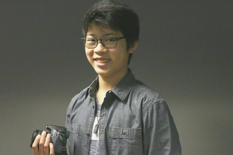 Junior+Jacob+Vu+poses+with+a+camera.+He+got+his+first+camera%2C+a+Sony+Handy-cam%2C+when+he+was+9+years+old.+Currently%2C+he+usually+uses+a+Canon+camera+for+filming+or+photography.